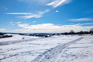 Winter landscape of nature. The river Oka froze and covered with snow. In nature in winter Russia. Clear blue sky with clouds.