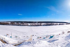 Ponarama winter landscape of nature. The river Oka froze and covered with snow. In nature in winter in Russia. Clear blue sky with clouds.
