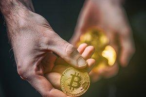Man holding Bitcoin