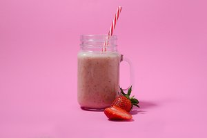 Pink smoothie in a mason jar glass