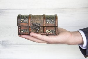 antique chest (antiques) in the hand