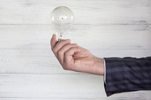 electric light bulb in the hand