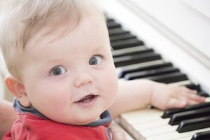 Baby at the piano plays