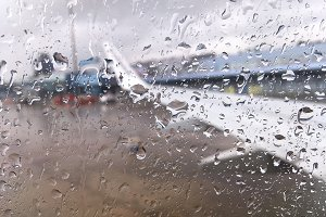 On a rainy day windows of the aircra