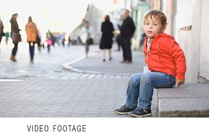 Little boy sitting alone
