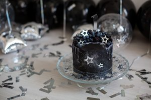 black cake with stars and berries