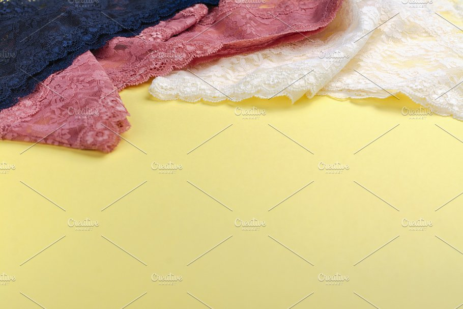 538dacb3f0 Set of beautiful lace panties on yellow background - Beauty   Fashion