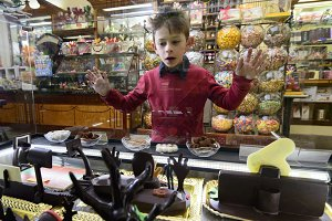 Child in the chocolat shop