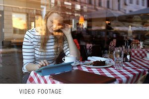 Woman in cafe using tablet PC