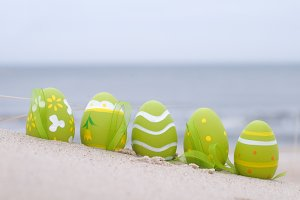 Easter eggs on sand