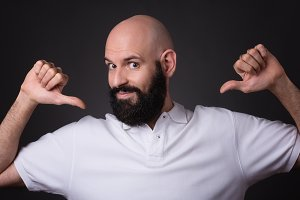proud bald and beared man confident pose