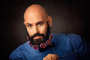 unshaven man with beard  and flowers