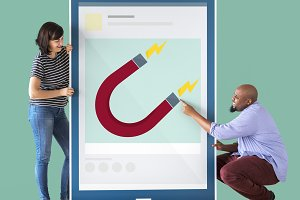 Couple holding a tablet with graphic