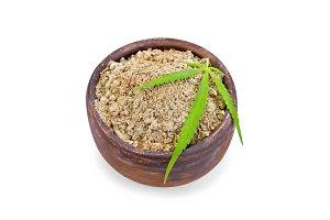 Flour hemp in clay bowl isolated