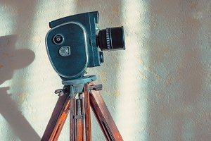 Old movie camera on tripod