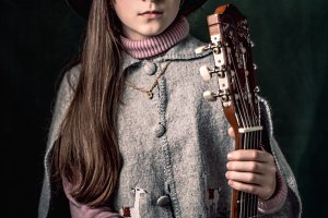 young lady guitarist