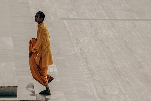 indian monk goes up the stairs