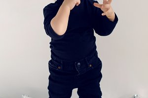 stylish baby boy in black rocker clothes and sunglasses