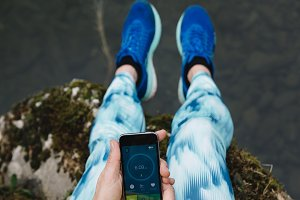 Woman using a running App in smartph
