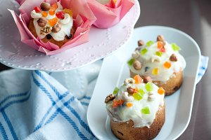Easter bread with white icing, candied fruits and nuts