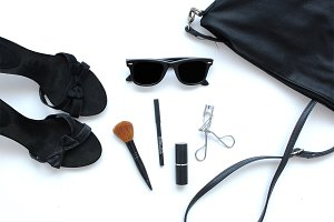 Female bag with cosmetics and shoes