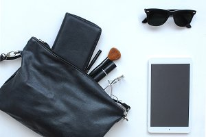 Female bag with cosmetics and tablet