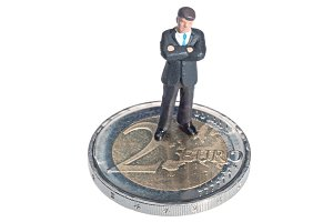 Businessman miniature over a coin