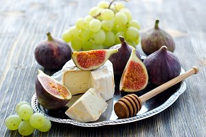 Cheese with grapes and figs