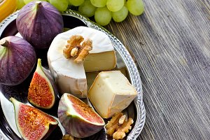 Cheese with fruits and nuts