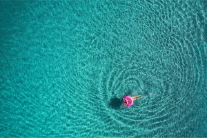 Aerial view of swimming woman