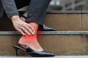 Business woman hurt ankle