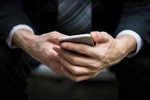 businessman hands holding smartphone