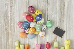 White old wooden table with colorful Easter eggs