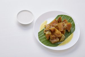Thai dessert food with Pumpkin in syrup on white dish