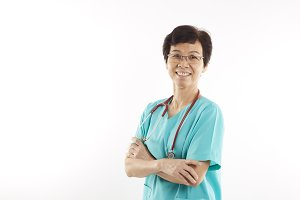 Female Doctor holding out stethoscope. isolated
