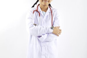 Little girl in a medical suit dream at the doctor