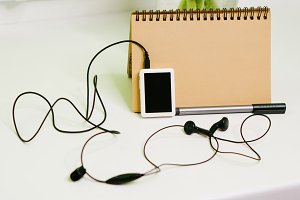 Music player, pen and notebook