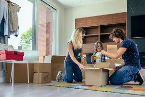 Family preparing moving toy box