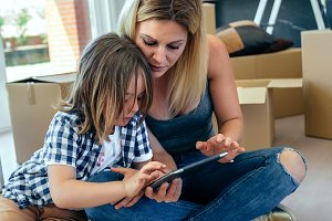 Mother and son playing the tablet
