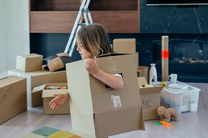 child playing with moving box