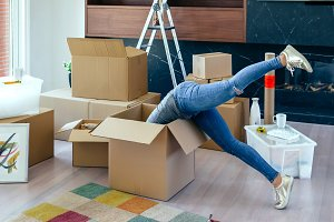 Woman inside a box preparing the move
