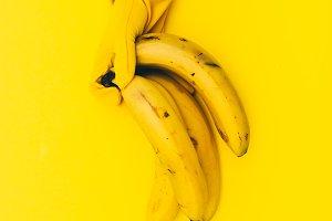 holding  bananas