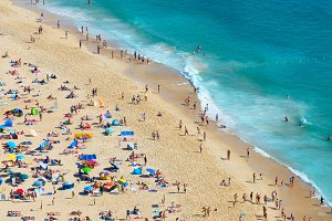 People rest on the ocean beach