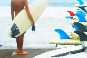 Surfboards on the beach, surfer