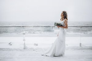 Amazing bride with flowers. Winter.