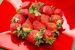 Strawberries on red tray