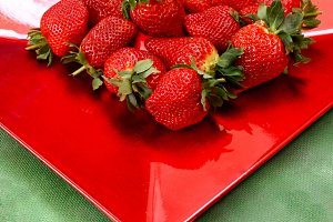 Strawberries in a red tray