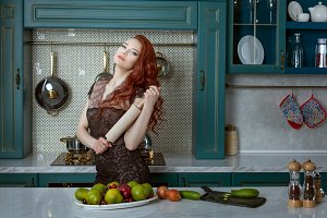 Red-haired woman holds a rolling pin