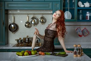 Portrait of a red-haired woman in th