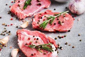 Fresh raw pork chops with spices